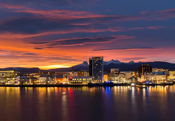 Bodø skyline in the midnight sun, seen from the sea