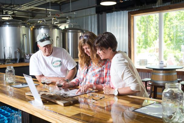 People reviewing brew menu at Corcoran Brewing Company