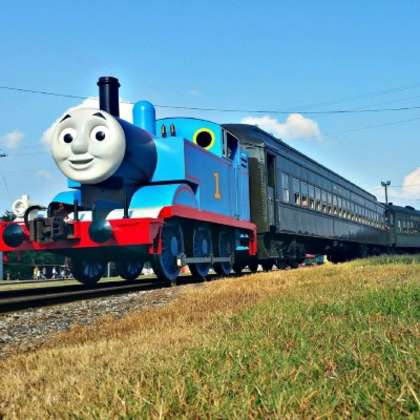 Thomas the Tank Engine rolling down the tracks