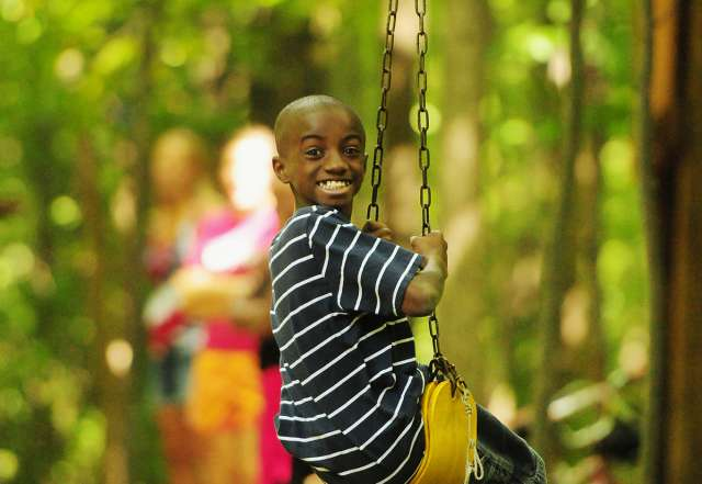 koa-canandaigua-people-boy-smiling-on-zipline