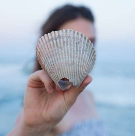 Girl Holding Shell