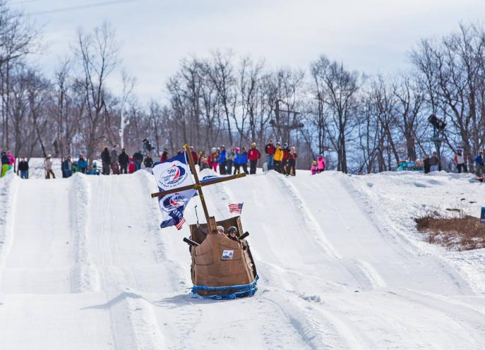 People sledding down a hill in a box derby at Montage Mountain in Lackawanna County