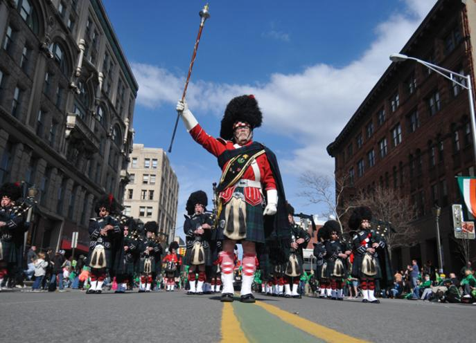 Bagpipers marching in the streets of downtown Scranton in the annual St Patrick's Parade in Lackawanna County, PA.