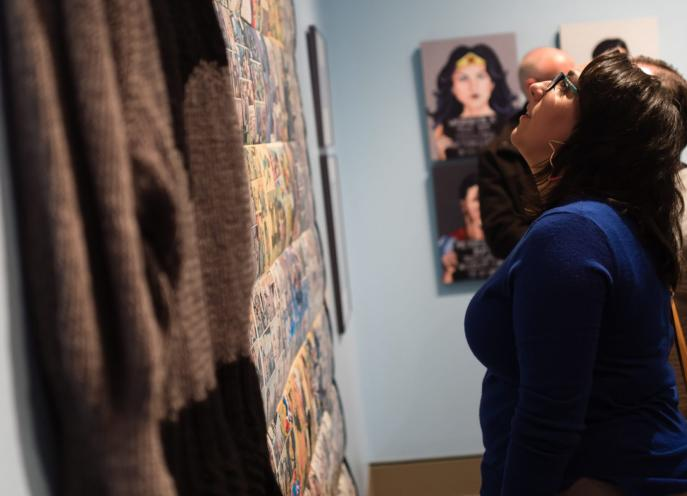 A woman looking at art exhibit inside the Everhart Museum in Scranton, Lackawanna County, PA.