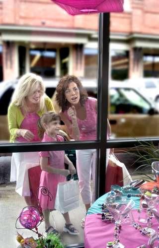 Shoppers Peering in Window