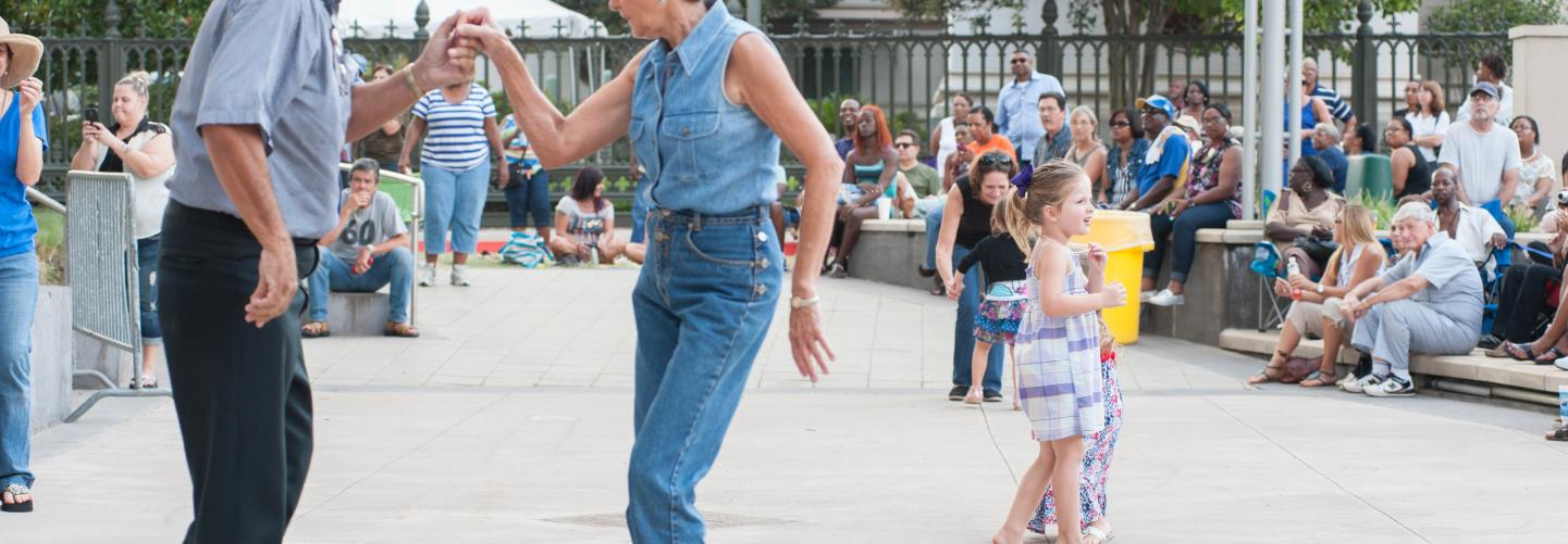 Couple and kids dancing at the Blues Festival