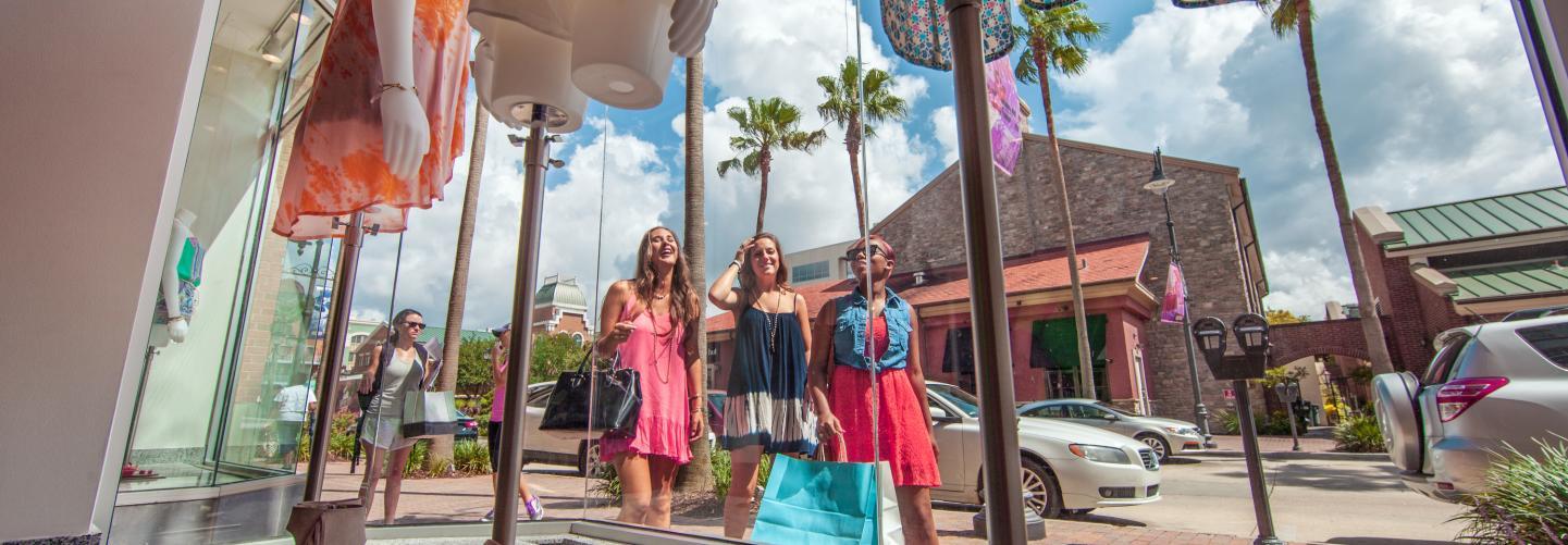 Three women window-shopping in Baton Rouge