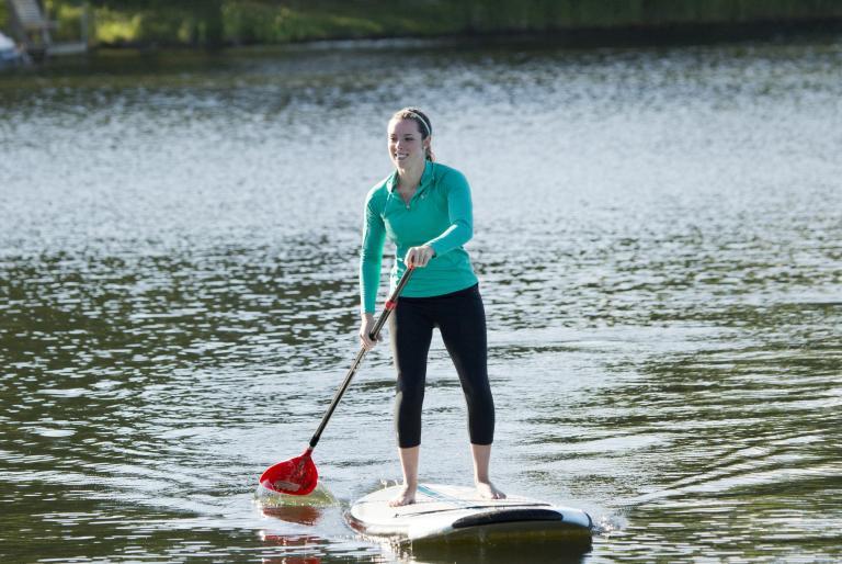 girl paddleboarding