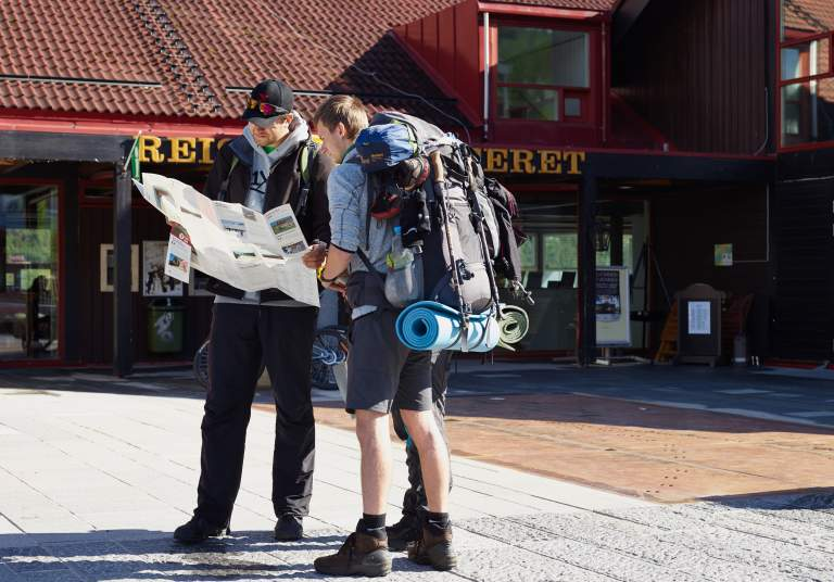 Couple reading a map outside Geilo Tourist Information