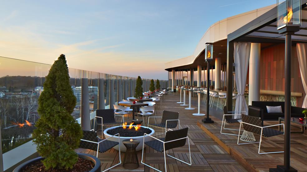 The view from eight stories up on the patio at VASO Rooftop Lounge with seating and firepits.