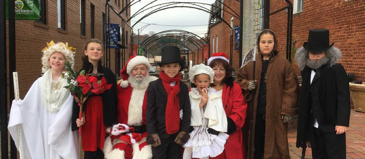 A Christmas Carol cast with Santa}