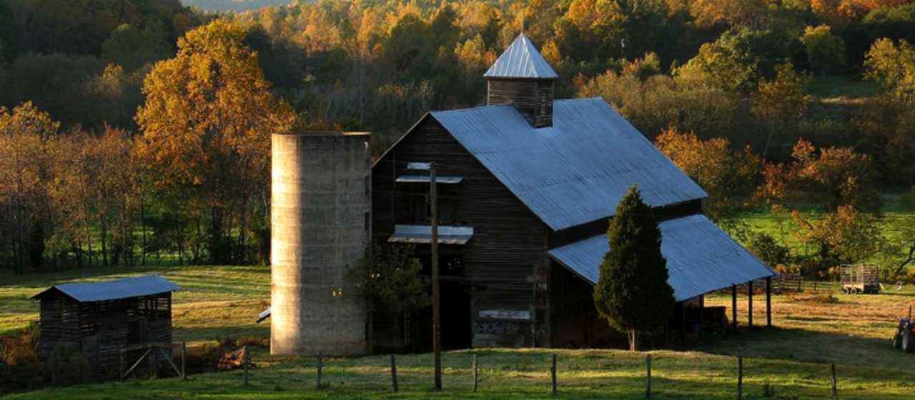 Old fashioned barn surrounded by fall color}