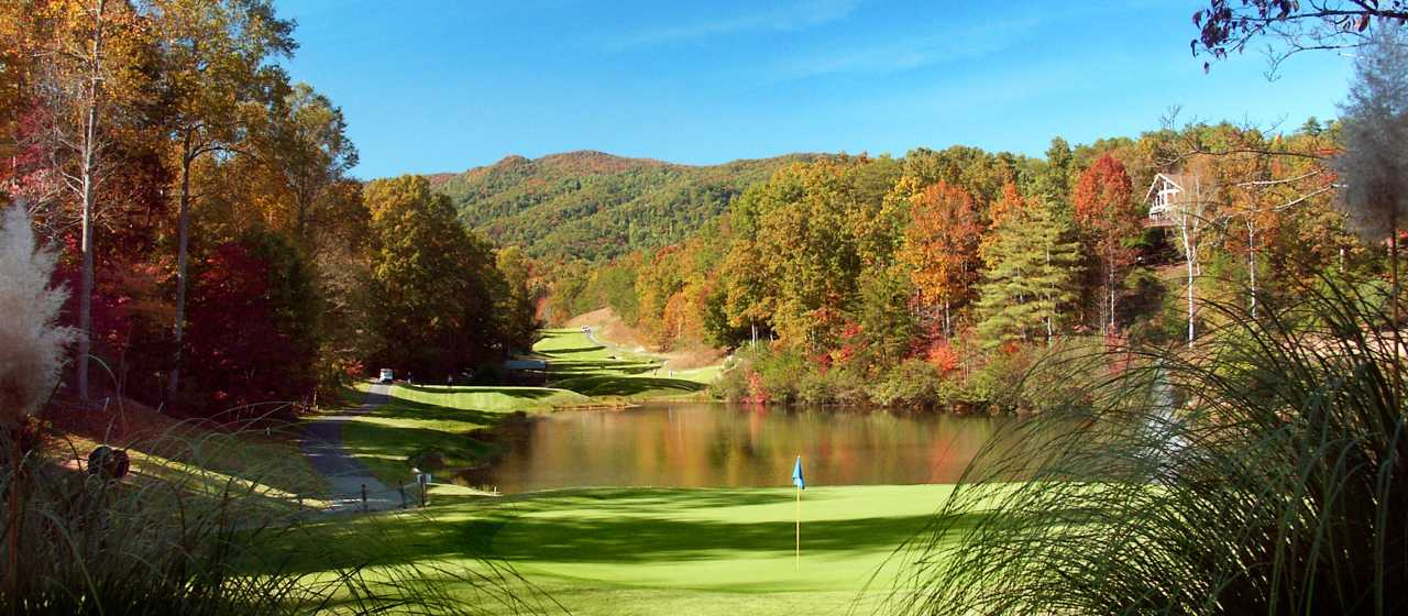 Fall color backdrop at Rumbling Bald Golf Course}