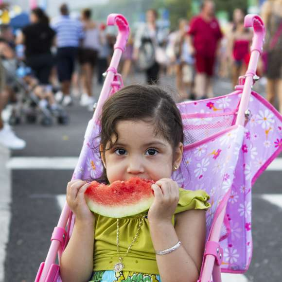 Girl eating watermelon at Taste of Chicago