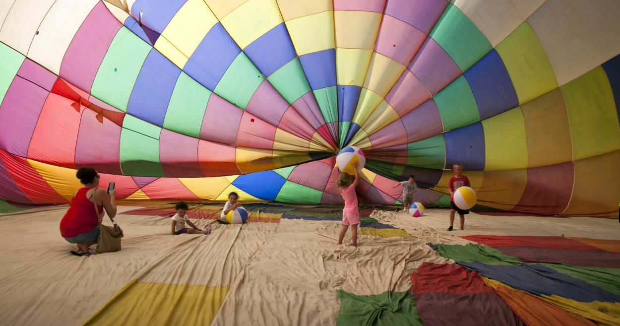 Children playing inside hot air balloon at Hendricks County Rib-Fest and Avon Balloon Glow