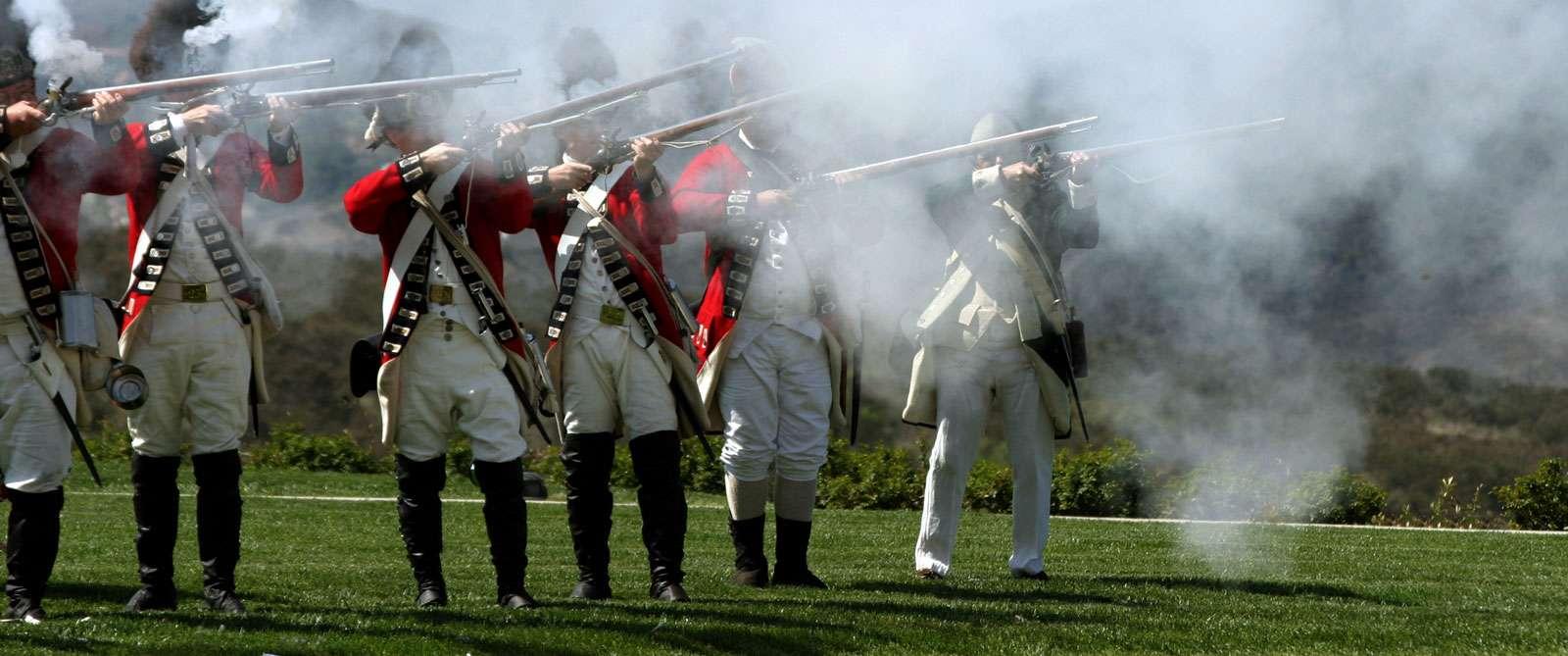bigstock-British-Army-Firing-A-Guns-1428958