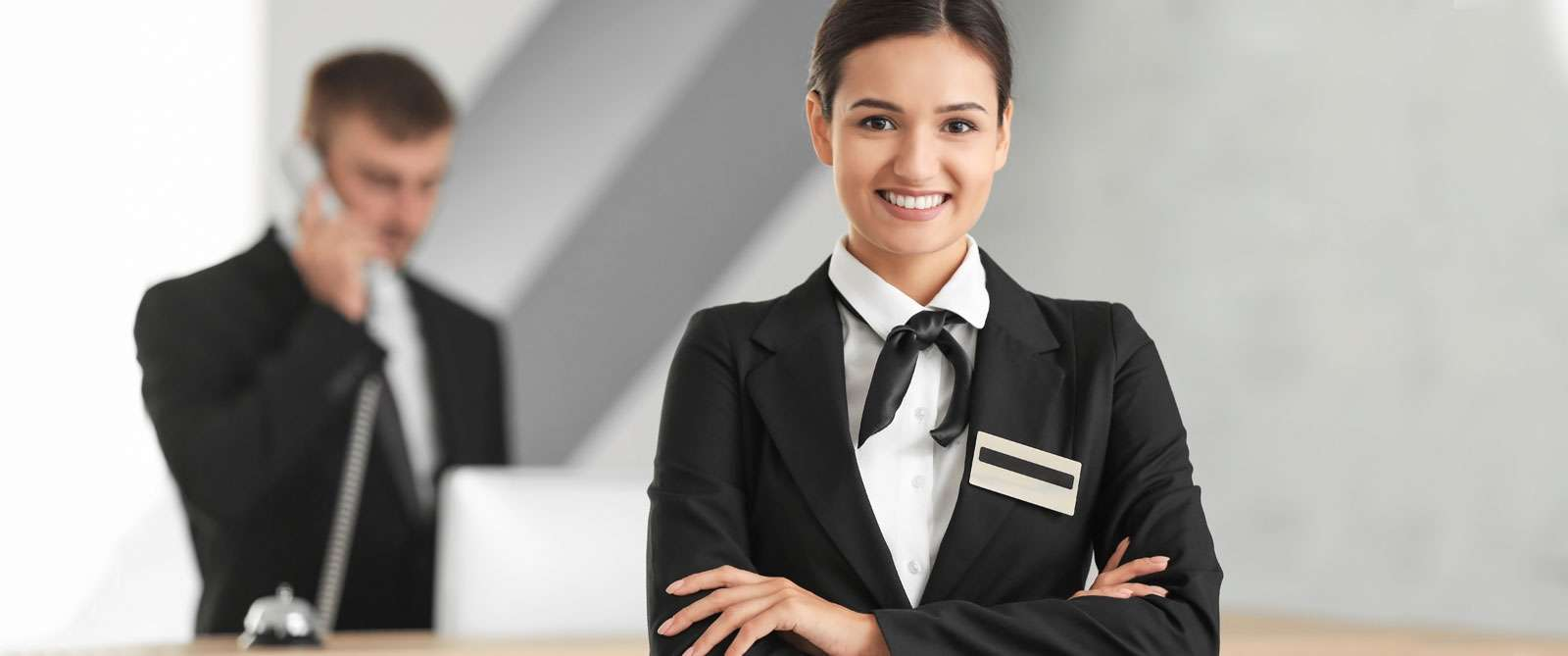 bigstock-Female-hotel-receptionist-at-w-208293751