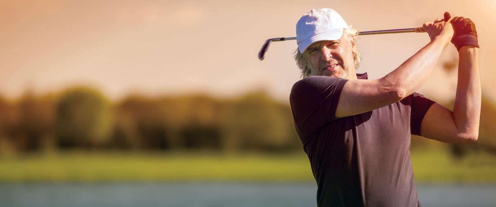 bigstock-Male-senior-golf-player-swingi-90763502