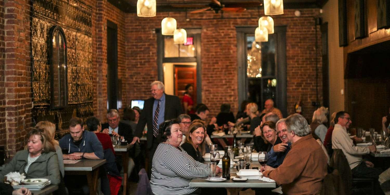 Diners enjoying themselves at Gospel Bird restaurant in New Albany