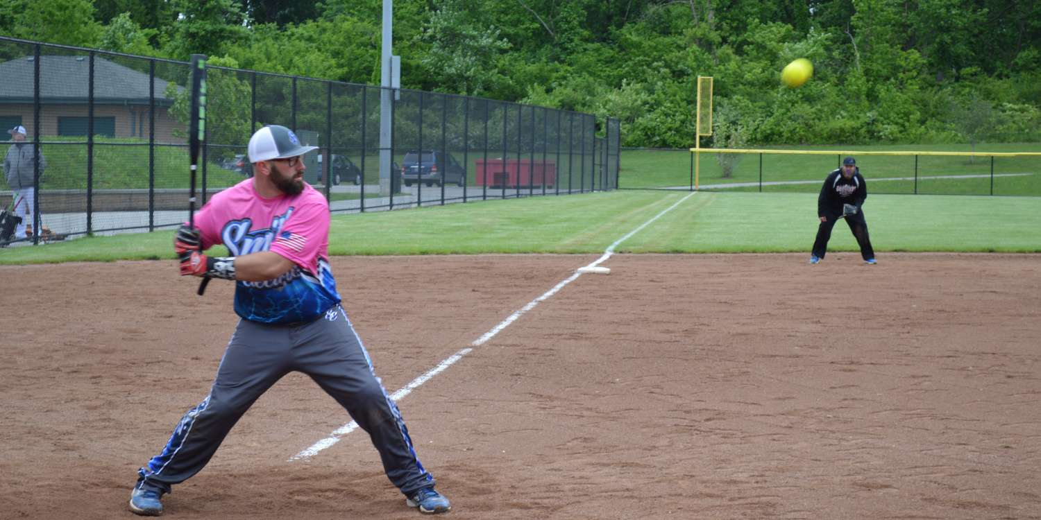 A batter takes a swing in a softball tourney
