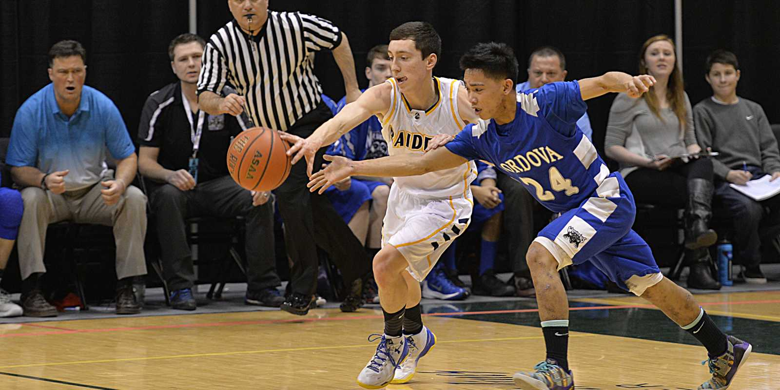 Players compete in Alaska's March Madness High School Basketball Tournament