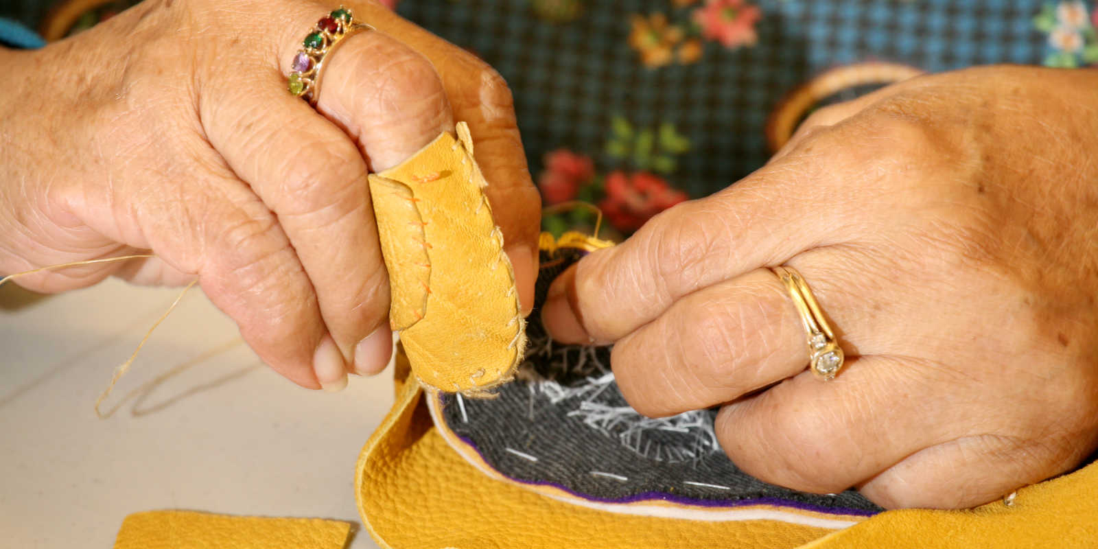 Alaska Native sewing at Alaska Native Heritage Center