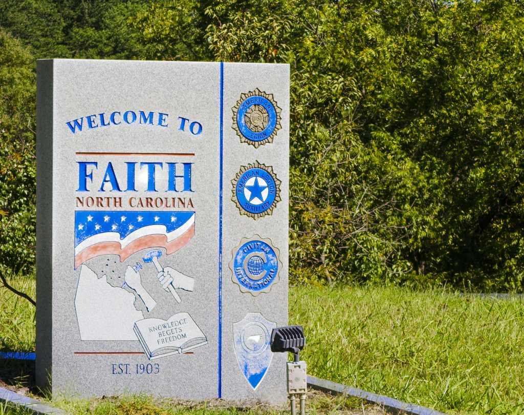 Monument welcoming you to the town of Faith