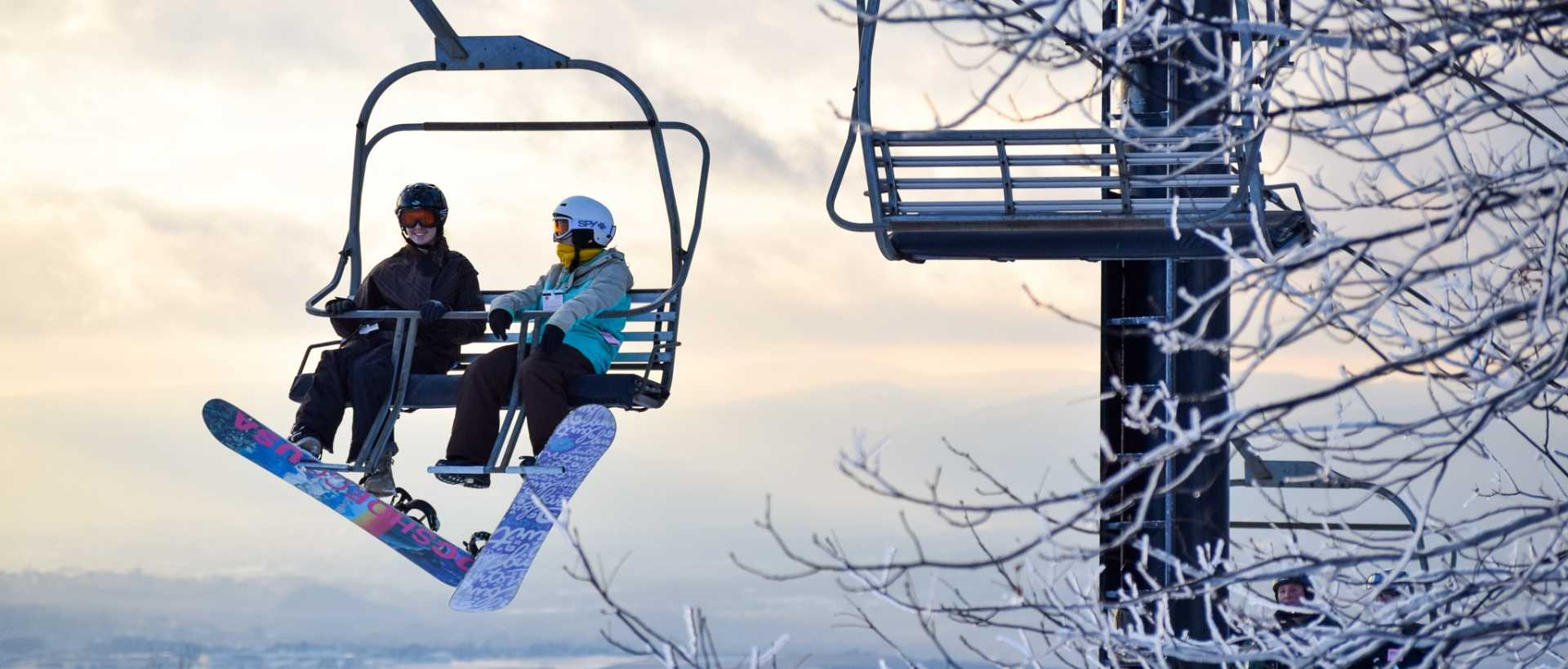 Snowboarders riding on the ski lift at Montage Mountain in Moosic, Lackawanna County, PA.