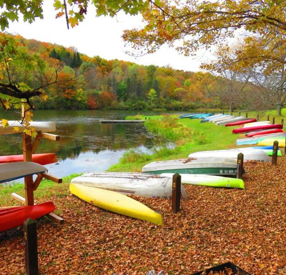 A view of canoes lined around Lake Lackawanna at the Lackawanna State Park in PA.