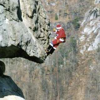 Extreme Santa Will Climb Chimney Rock
