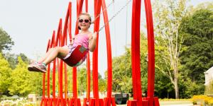 Red swings at the Abernathy Greenway Playable Art Park