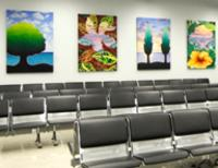 Photo of four paintings which are part of the Corresponding Vibrations collection.