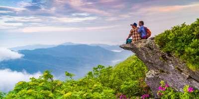 Hiker Couple at Craggy Pinnacle at Sunrise