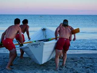 Lifeguards taking out a boat