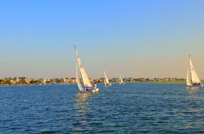 Several sailboats on the waters near Wrightsville Beach.