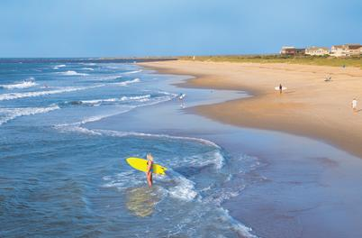 Girl with yellow surfboard