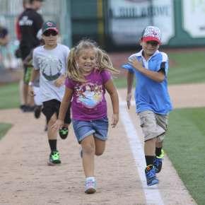 Kids running on Parkview Field's base line
