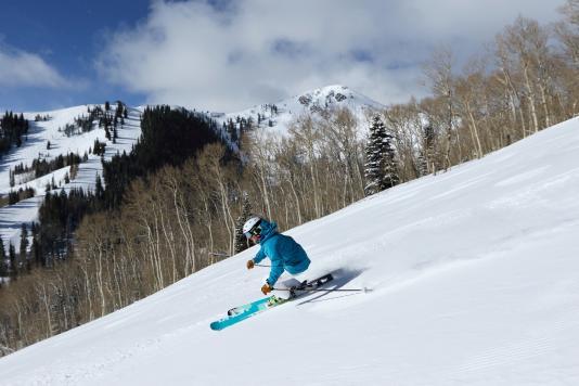 Woman Skiing Groomed Run