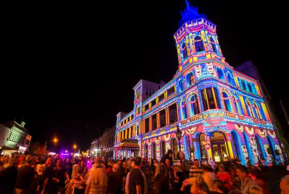 Building lit up for the White Night Event in Melbourne
