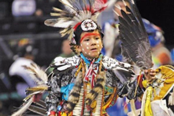 A young dancer in traditional Indigenous regalia