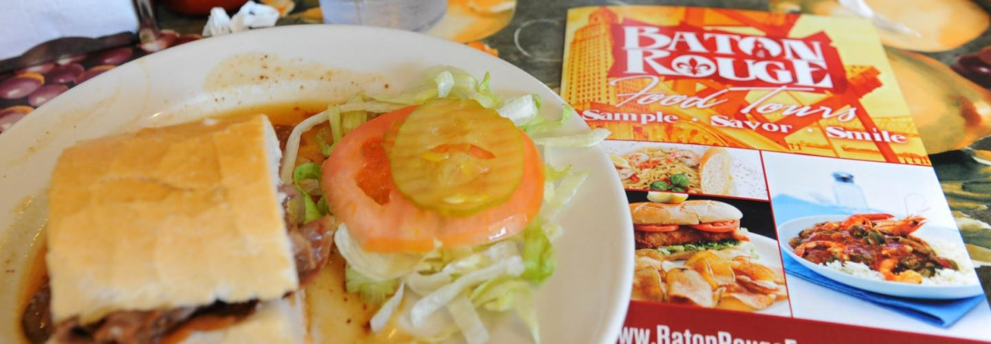 Po Boy and Baton Rouge Food Tours brochure on table