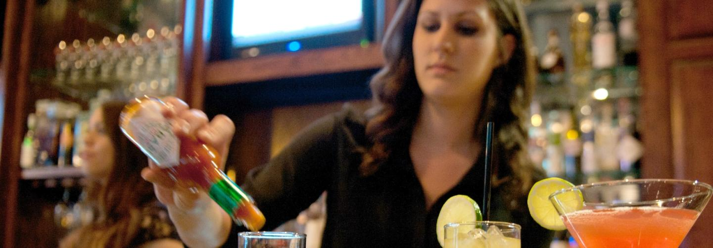 Bartender pouring Tabasco into a custom crafted cocktail