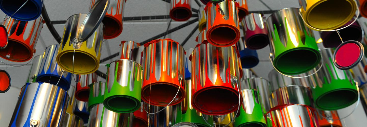 Art Installation with hanging paint cans of different bright colors