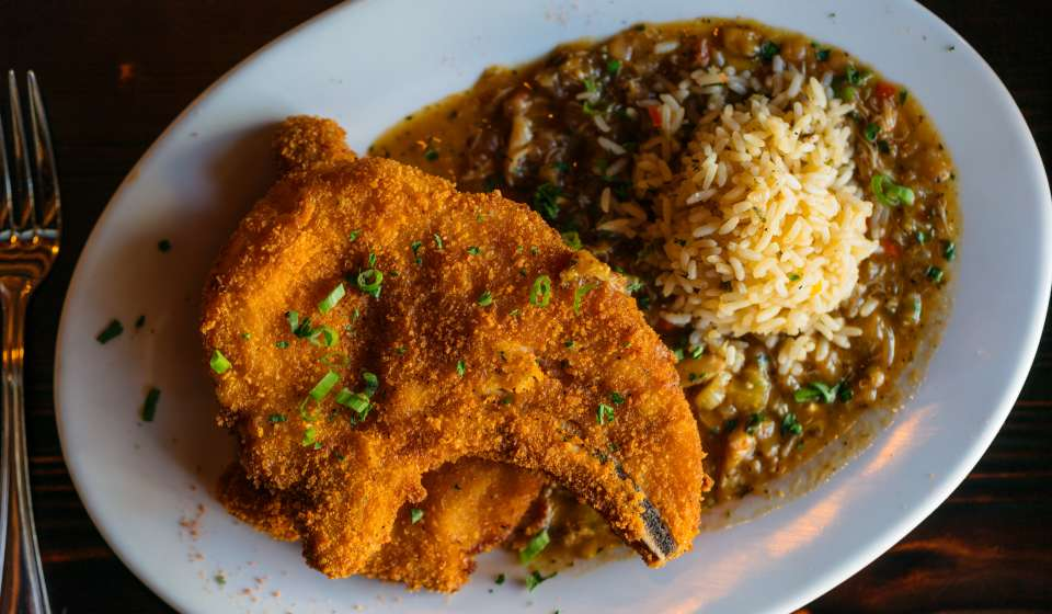 Fried Pork Chops with Crab Étouffée - Galliano Restaurant - Warehouse District