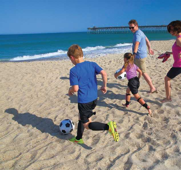 Family Soccer on beach