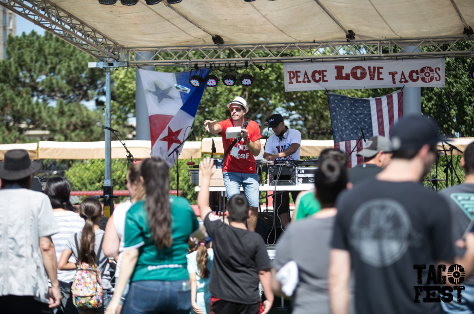Man throws prizes from stage at ICT Taco Fest in Wichita, Kansas