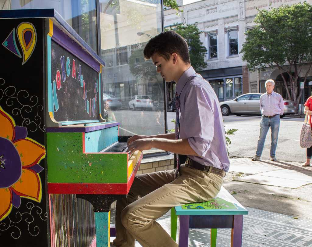 Playing piano at Come Tickle our Ivories in Downtown Salisbury