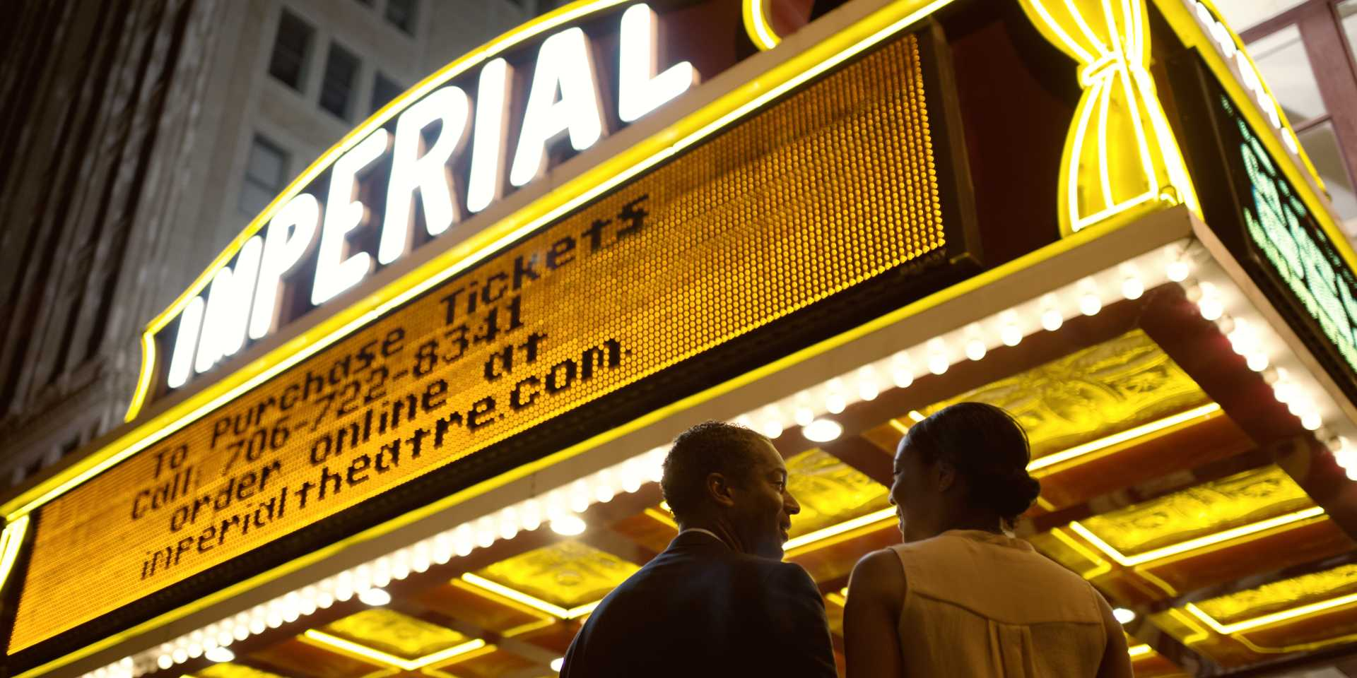 Couple in Front of Imperial Theatre Marquee