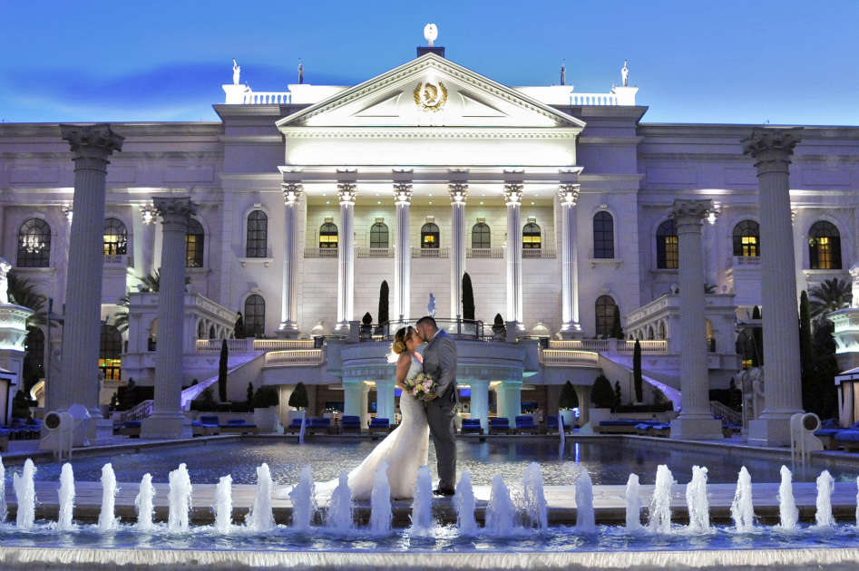 Married Couple in Front of the Fountains at Caesars Palace