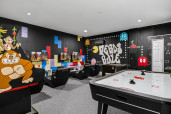 Game on in this fun retro themed games room